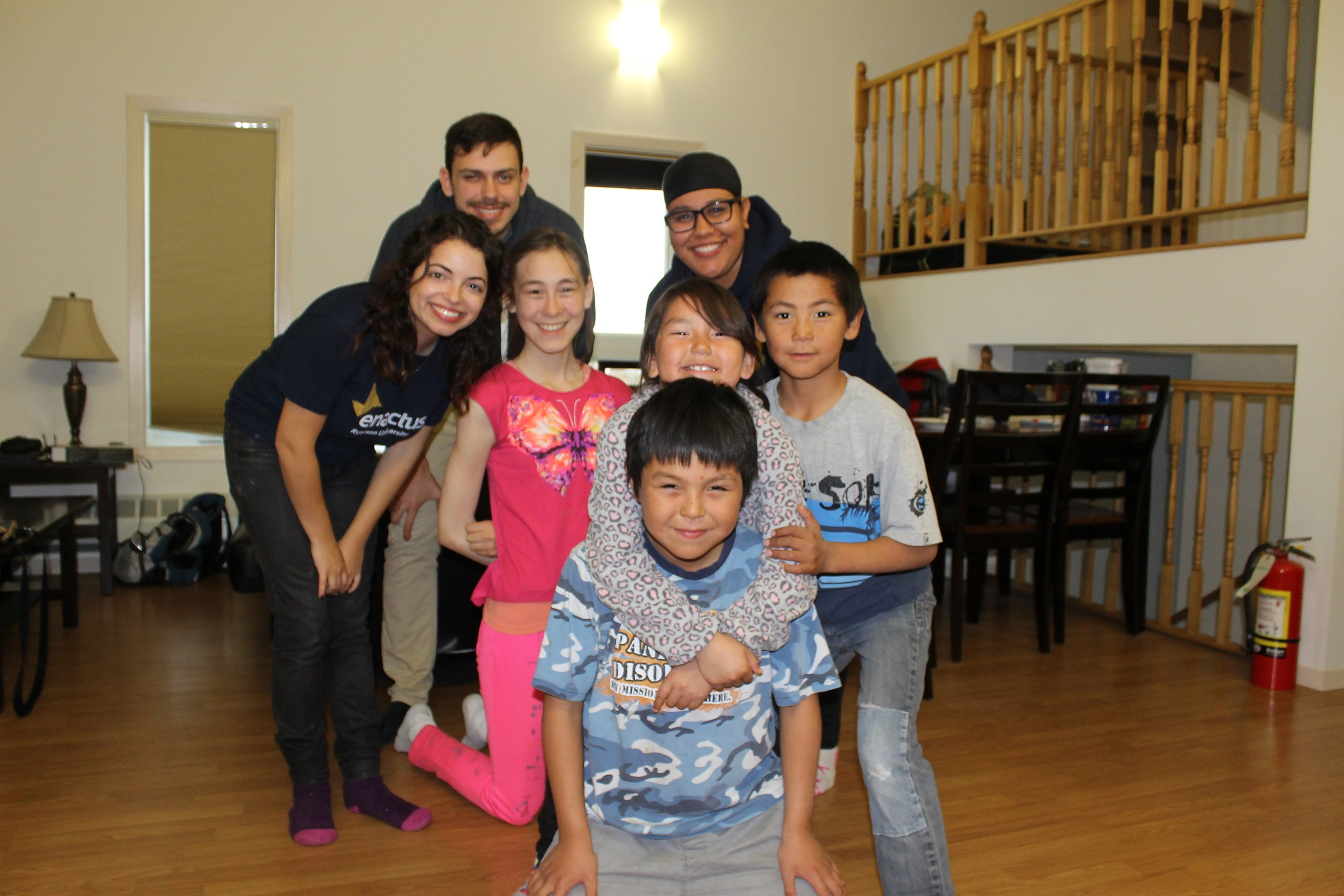 Members of Enactus Ryerson with local children