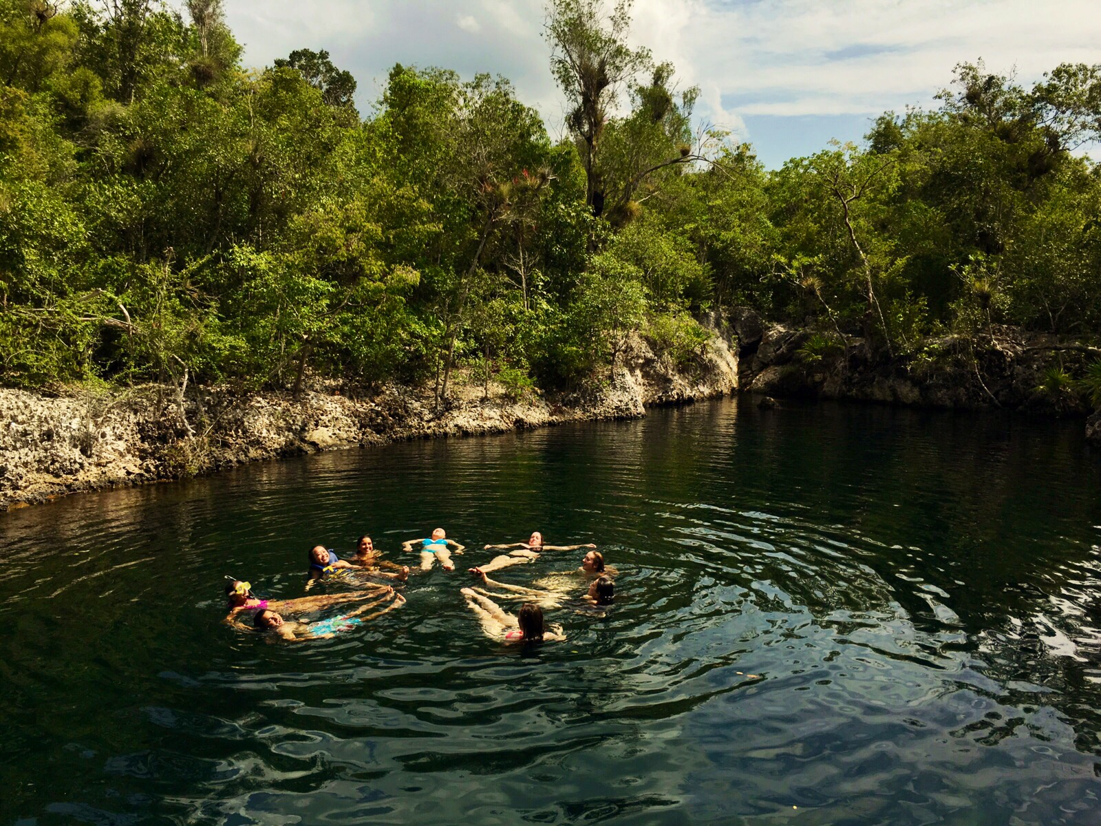 Students swimming in cenote