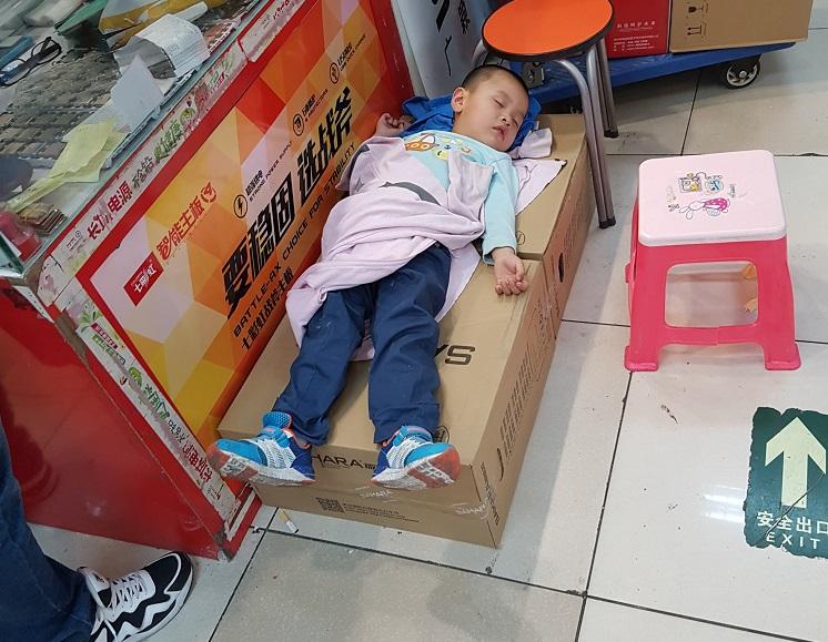 Sleeping boy in market