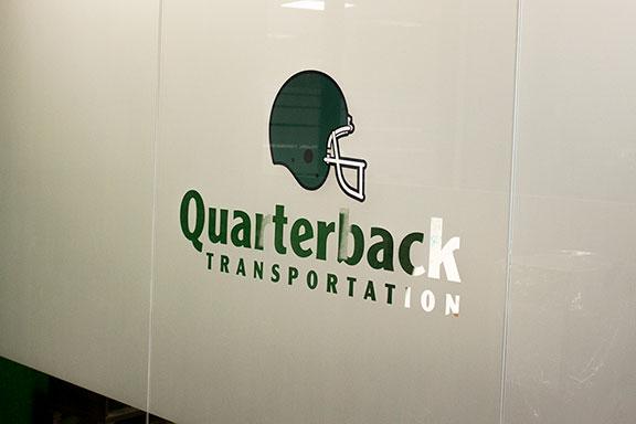 Quarterback Logo Wall