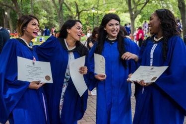 Graduates laughing at convocation